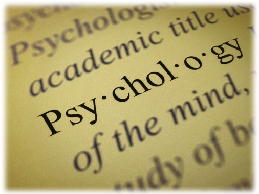 Psychology dictionary definition text with meaning printed on paper