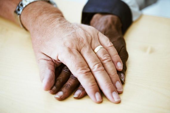 Support and friendship through clasped hands