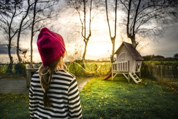 Child looking at play house parentification
